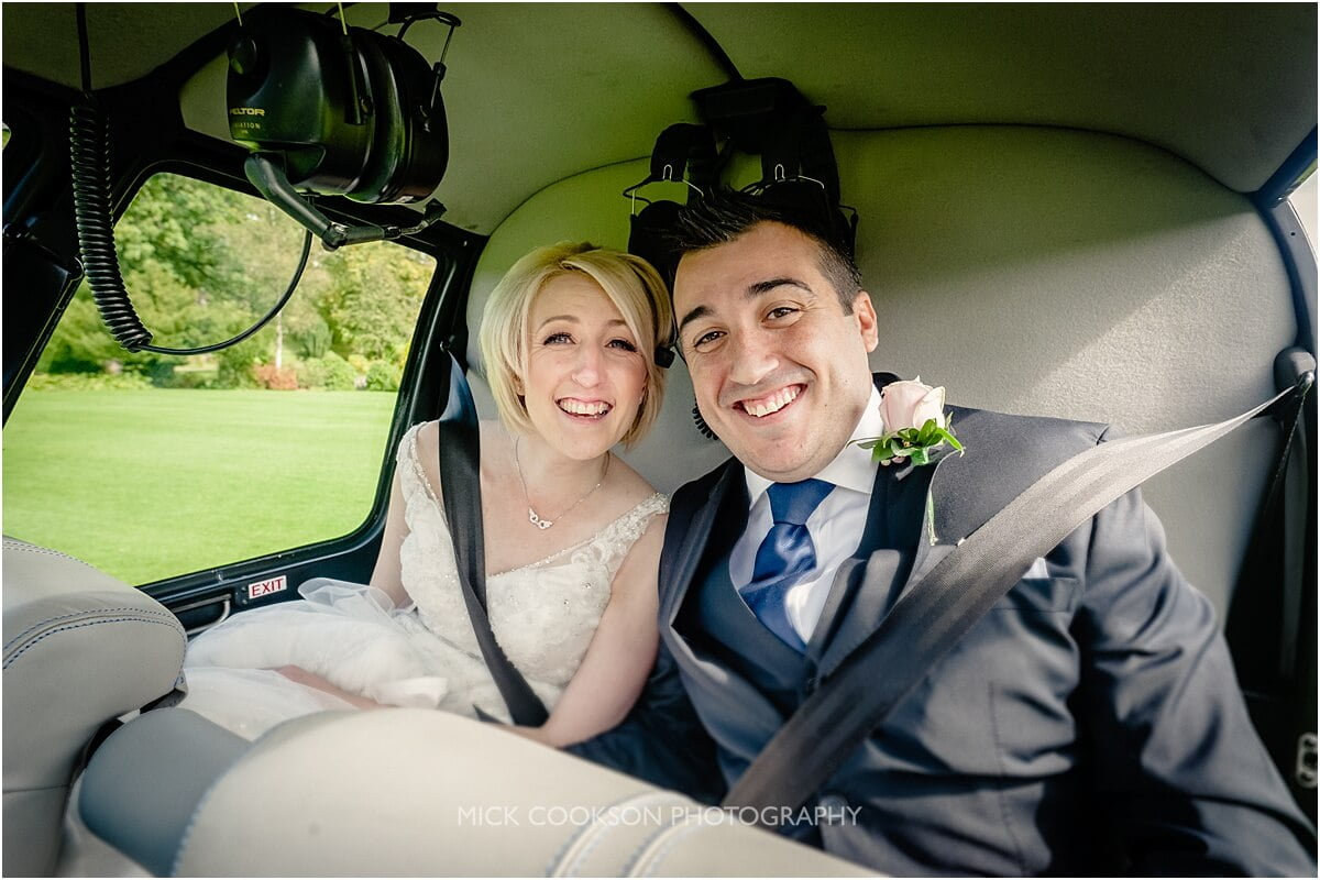 bride and groom in a helicopter