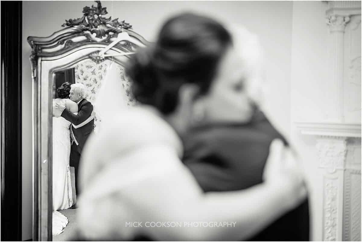 bride hugs her dad at Tyn Dwr Hall