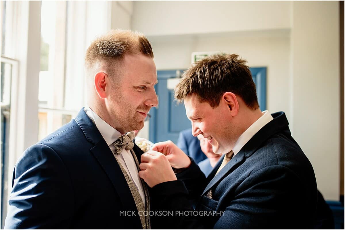 groom has his button hole put on