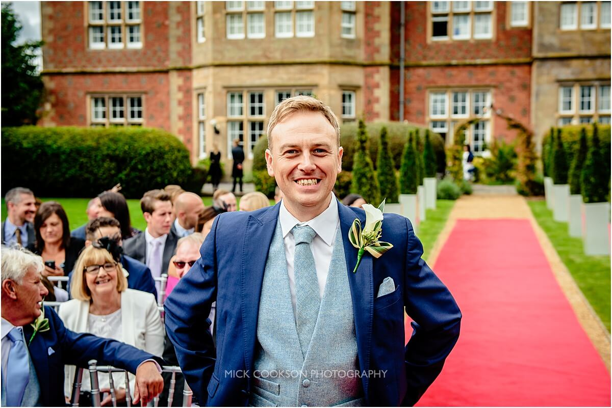 groom at a crnage hall outdoor wedding ceremony