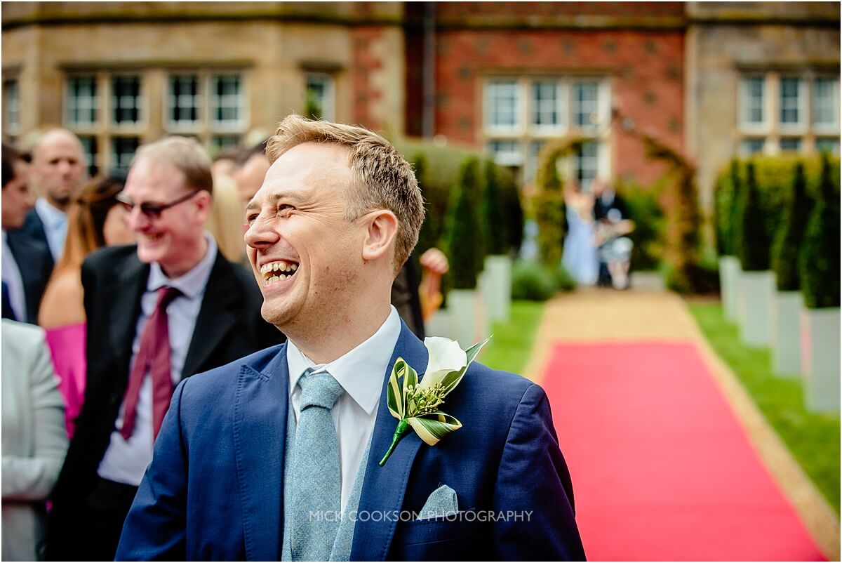 laughing groom photo taken at cranage hall