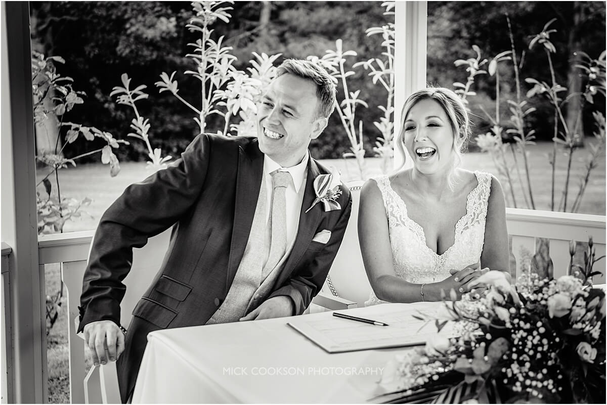 signing the register at an outdoor wedding ceremony