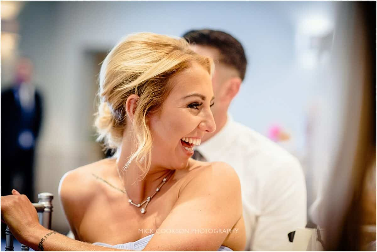 happy bridesmaid during the speeches