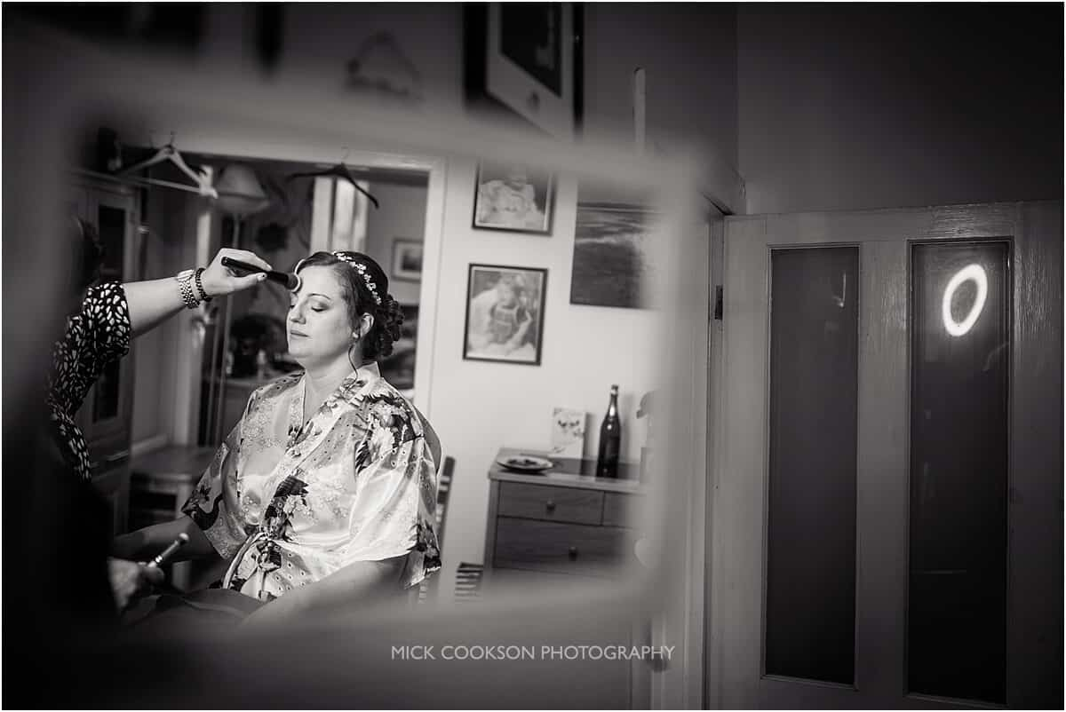 black and white photo of a bride getting ready