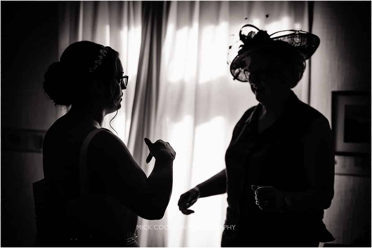 silhouette photo of a bride getting ready