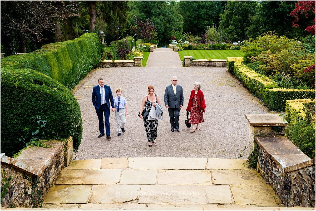 wedding guests arriving at eaves hall