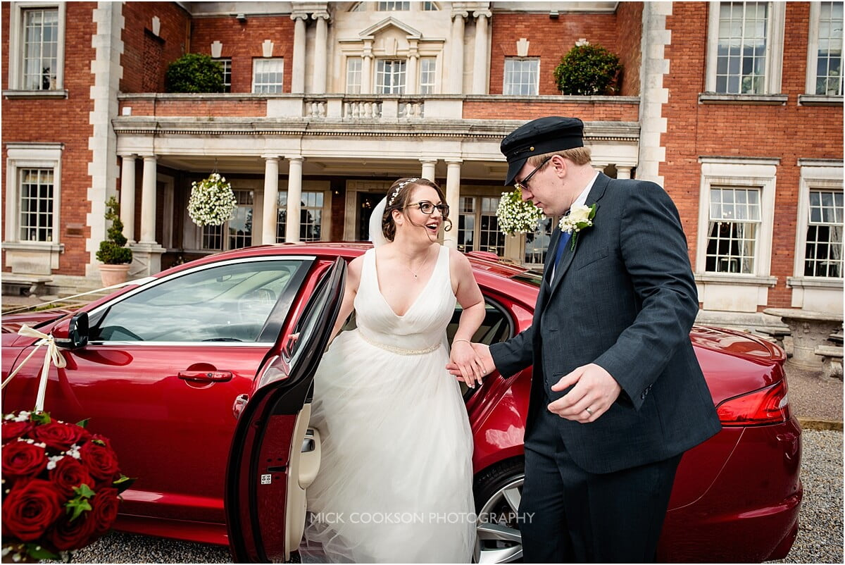 bride getting out of a wedding car at eaves hall