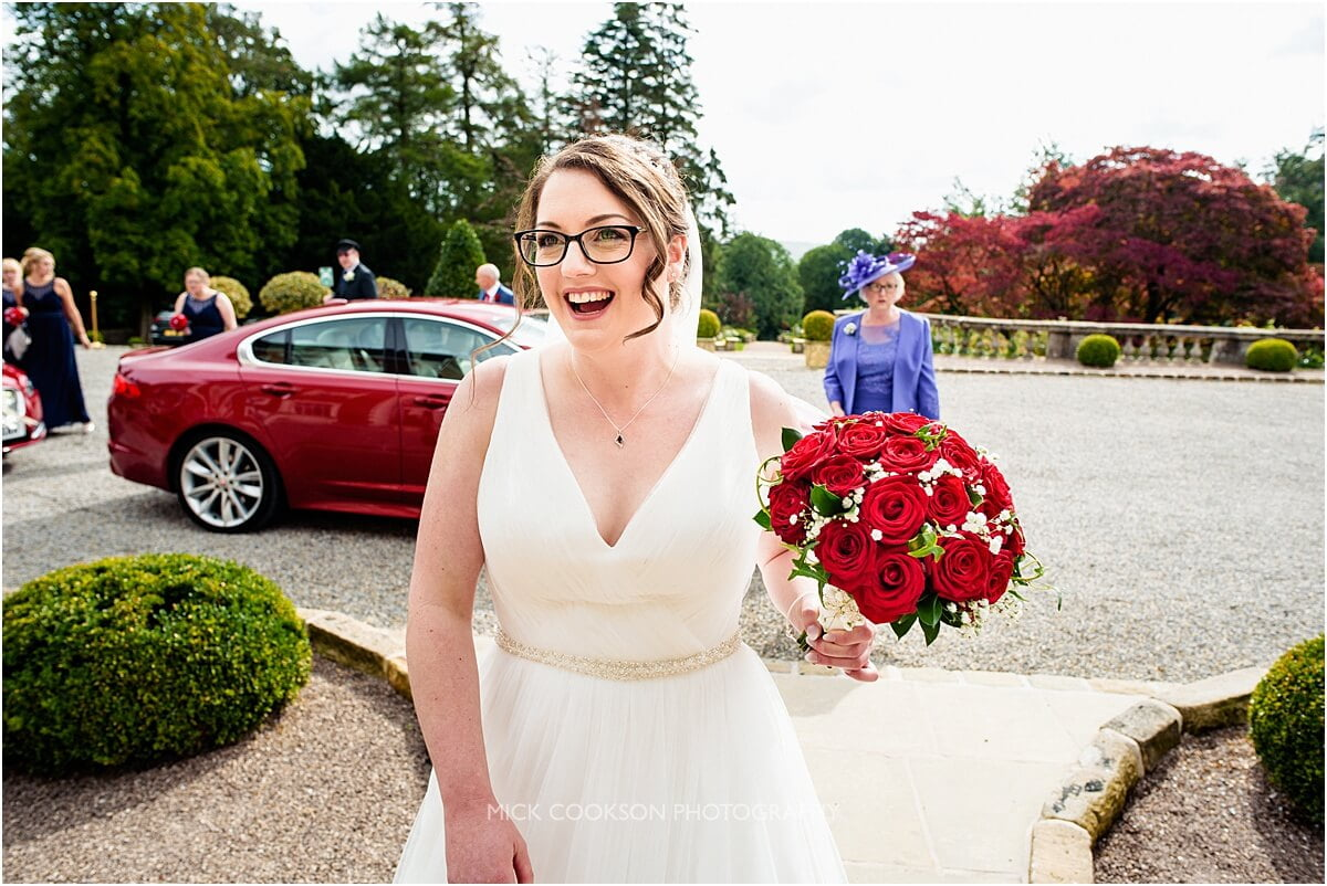 excited bride entering eaves hall