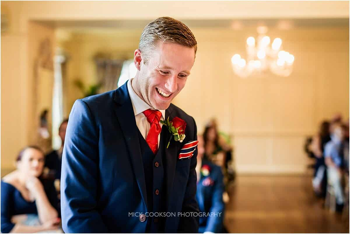 excited groom at eaves hall