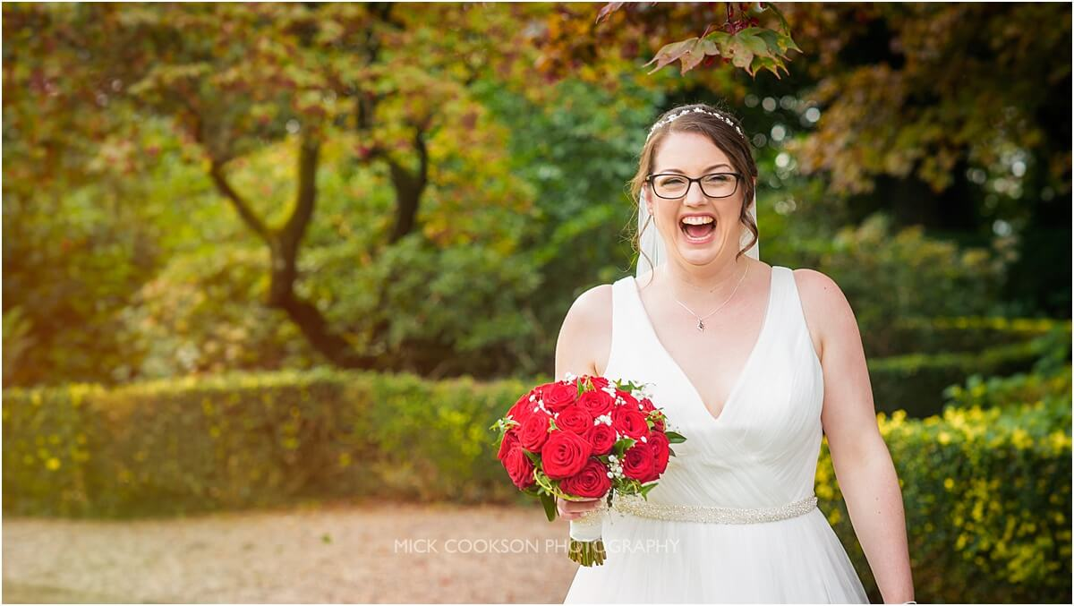 happy bride on her wedding day at eaves hall