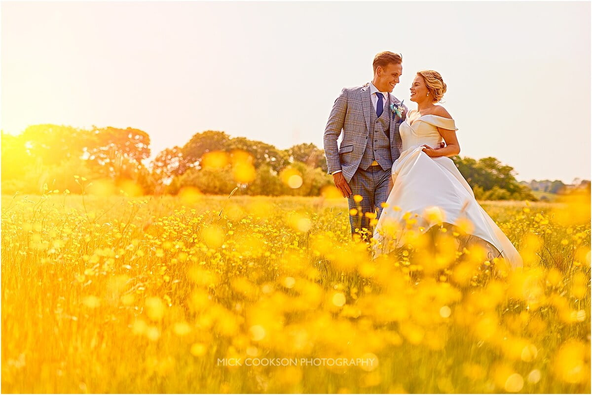 bride and groom photo in a field of buttercups